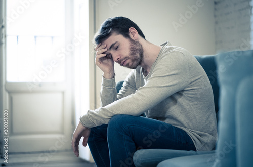 Obraz Young man suffering from depression hopeless and alone at home - fototapety do salonu