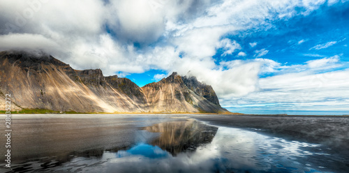 Papiers peints Cappuccino Splendid sunny day and gorgeous reflection of Vestrahorn mountaine on Stokksnes cape in Iceland.