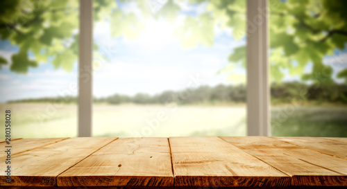 Desk of free space and blurred background of window