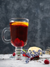 Hot Fruit Raspberry Tea With Herbs And Lavender In A Glass Cup