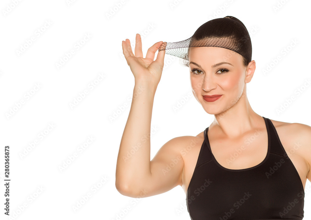 Fototapeta Young beautiful woman posing with wig cap on white background