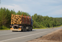 Logging Truck In The Summer Going On The Highway.