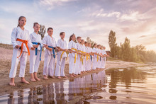 Group Of Kids Training Karate Martial Arts On Sunset Beach