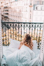 Young Woman On Balcony In Paris