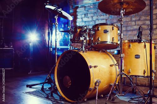 Modern drum set shot in smoky dark studio - 280368227