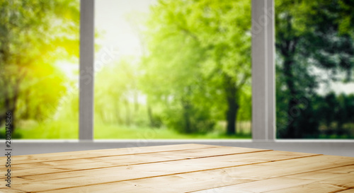 Poster Pays d Asie Table background and spring time. Green nature in blurred view in distance. Empty space for decoration and an advertising product.