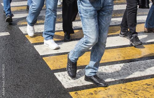 Fototapeta people walking on a pedestrian crossing obraz na płótnie