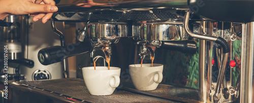 Hand make coffee shot with the espresso machine in the espresso bar Canvas Print