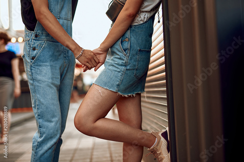 Fototapety, obrazy: Beloved couple staying on street holding hands