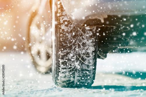 Obraz na plátně  Close-up of car wheels rubber tires in deep winter snow