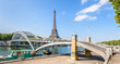 Panoramic view of the Debilly footbridge, a pedestrian through arch bridge over the river Seine, built in 1900 not far from the Eiffel tower in Paris, France.