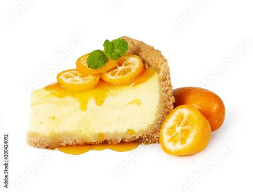 Photo  Piece of cheesecake with fresh kumquat and mint
