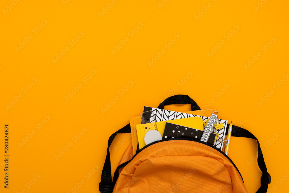 Fototapety, obrazy: Back to school concept. Backpack with school supplies on yellow background. Top view. Copy space. Flat lay