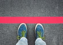 Women's Feet In Sneakers Stand...