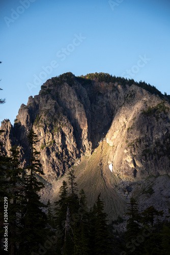 Dawn alpenglow over jagged peaks in the Alpine Lakes Wilderness Wallpaper Mural