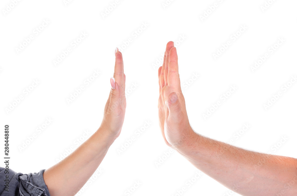 Fototapeta Male and female palms clap each other. High five.