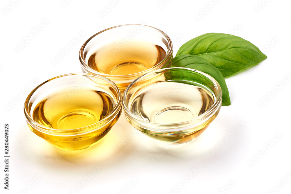 Fototapety, obrazy: Vegetable, olive oil and apple vinegar in a bowl, isolated on white background