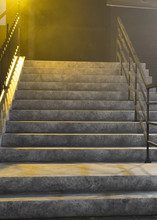 Bright Yellow Light Shining Above Concrete Stairway