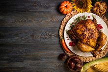 Roasted Whole Chicken Or Turkey With Autumn Vegetables For Thanksgiving Dinner On Wooden Background. Thanksgiving Day Concept. Top View, Copy Space