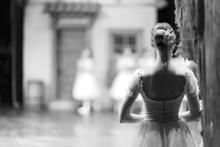 Ballerina In Costume And Pointe Is Standing Backstage During The Intermission Of The Performance