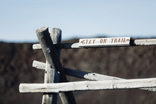 Stay On Trail Sign On A Old Wooden Hitch And Post And Beam Fence