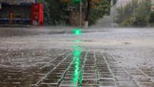 Heavy Rain On The Sidewalk And...