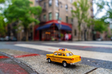 Vintage Old Taxi Toy In New York City Most Popular Places. Classic Yellow Cab In Manhattan And Brooklyn. The Symbol Of New York. Driving A Taxi Through Brooklyn.