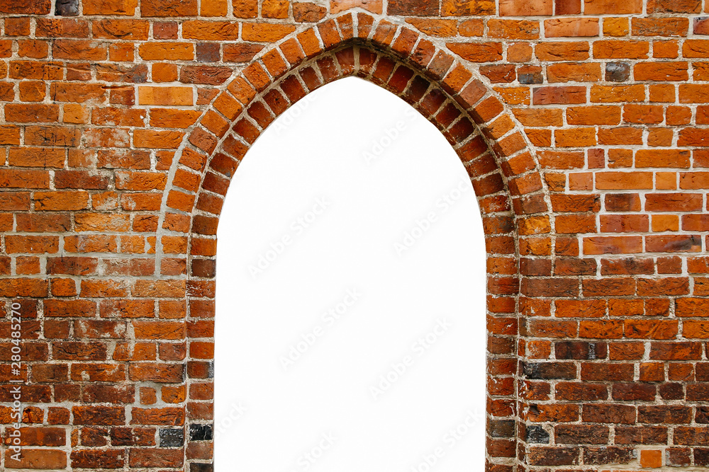 Fototapeta Portal door arch way window frame filled with white in the center of ancient red orange brick wall with as surface texture background.
