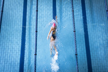 High Angle View Of Athlete Swimming In Swimming Pool