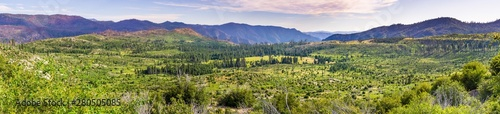 Valokuva  Panoramic view of beautiful green meadows and forests in Yosemite National Park,