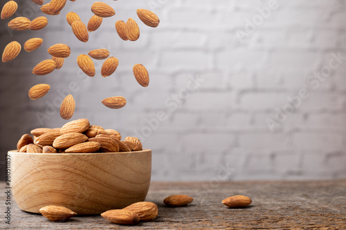 Fotomural  wood table with almonds.