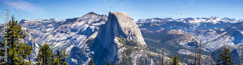 Panoramic view of the majestic Half Dome and the surrounding wilderness area wit Wallpaper Mural