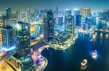 Scenic nighttime skyline of big modern city. Aerial view of Dubai Marina, UAE.