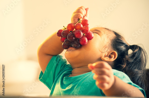kid eating grape funny vintage style