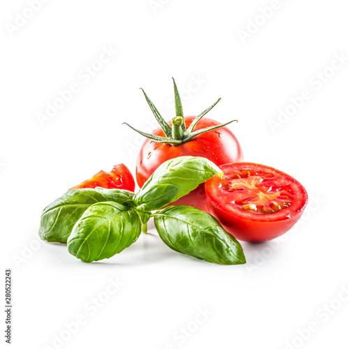 Obraz Close-up fresh tomato with basil isolated on fhite background - fototapety do salonu