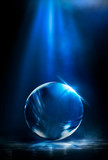Glass ball on the dark night scene with reflection. Abstract dark background, magic ball. Night view.
