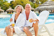 Leinwandbild Motiv Senior couple in spa vacation at the pool
