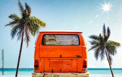 Orange summer car on beach and free space for your decoration.