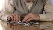 Senior man collecting puzzle, alzheimer disease awareness concentration exercise