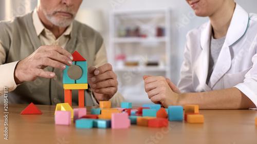 Fototapeta  Psychologist mentoring senior male, training to identify problems, homesickness