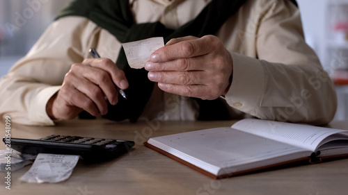 Fotomural  Pensioner looking at checks, calculating expenses for utilities and purchases