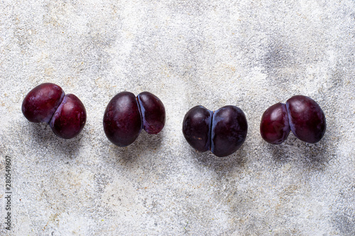 Ugly plums. Abnormal organic fruit Wallpaper Mural