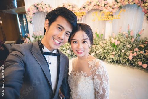 Canvas Print Bride and groom selfie photo at wedding ceremony..