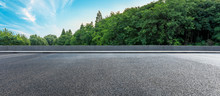 Asphalt Highway And Green Forest With Beautiful Clouds Landscape