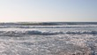 Waves on a sea shoreon a sunny day. Slow motion. Vacation concept