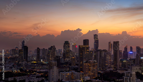 Panorama of cityscape with sunset over the building and blue sky at bangkok ,Thailand Wallpaper Mural