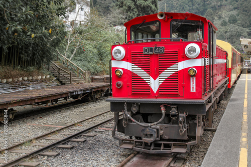 Alishan,taiwan-October 15,2018:The old red Train in Alishan Line (downhill) come back to Chiyi train station at foggy day.