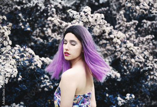 Young dreamy woman portrait in nature