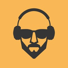 Man With A Beard Wearing Glass...