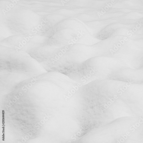 Drifts of snow over a lumpy landscape